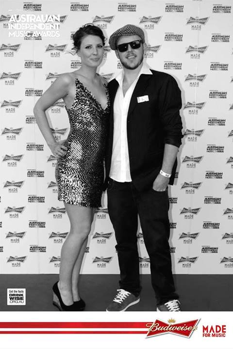 Simon Wright and Hannah Blake on the red carpet at the 2013 Music Oz Australian Independent Music Awards.